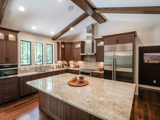 Ivory Gold granite kitchen island and countertops by Capital Granite, Inc.