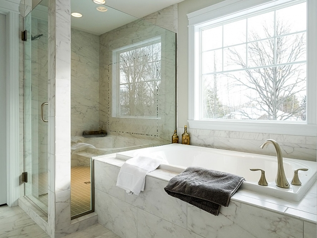 marble tub deck and shower by Capital Granite, Inc.