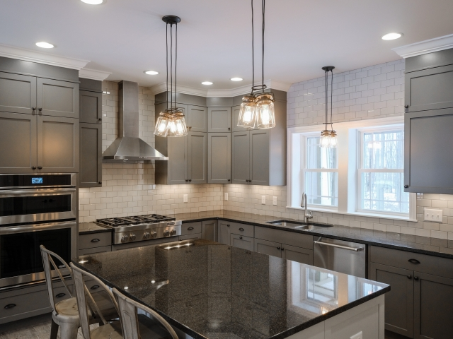 kitchen countertops and island by Capital Granite, Inc.
