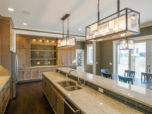 Ivory Gold granite kitchen countertops by Capital Granite, Inc. and Cobblestone Home Builders